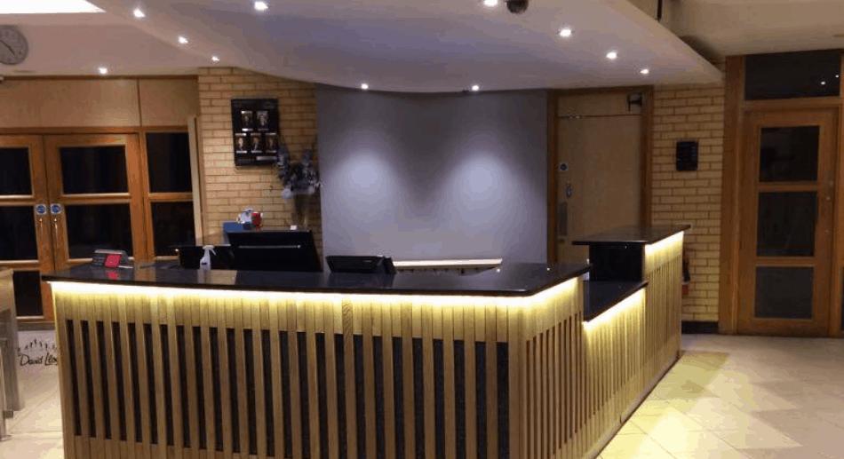 Reception area illustration including worktop, cladding and LED under-lights
