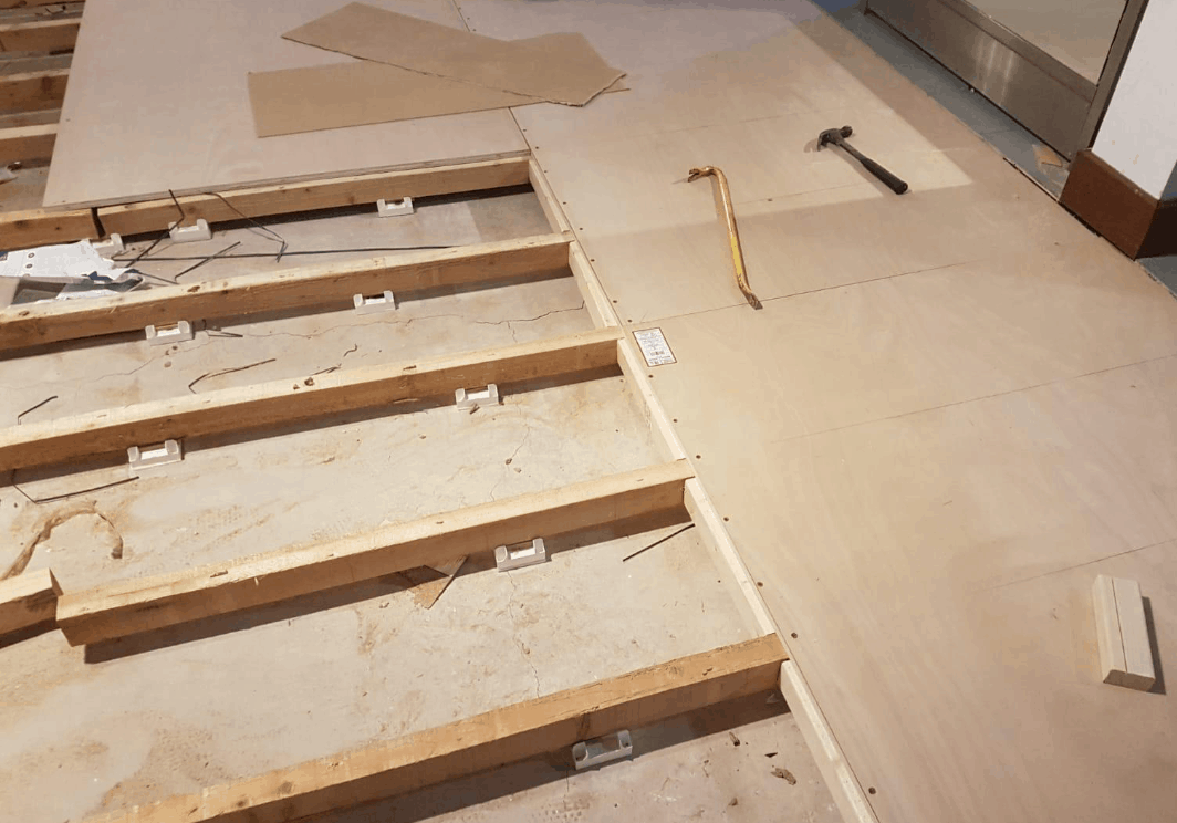 Flooring repairs after weights being dropped through the floor.